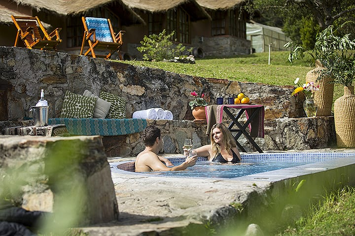 relaxing at pool in lodge in salkantay trek